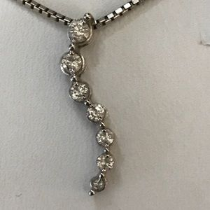 14kt pendant with 7 diamonds. From Kay jewelers.